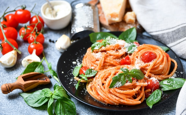 Spaghetti pasta with tomato, parmesan cheese and basil