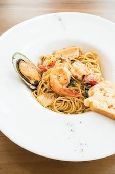 Spaghetti seafood in white plate