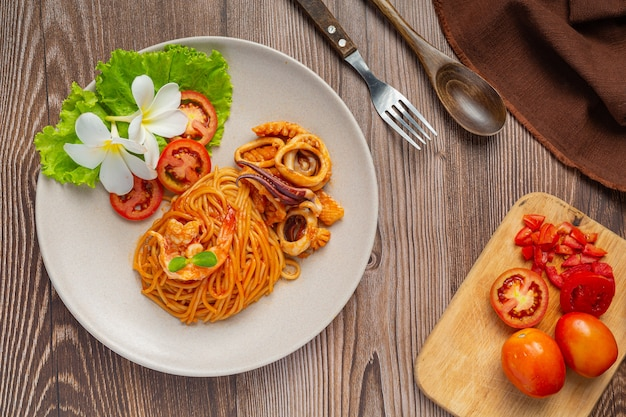 Spaghetti seafood with tomato sauce decorated with beautiful ingredients.