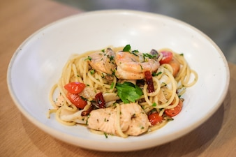Spaghetti spicy seafood with basil & black pepper.