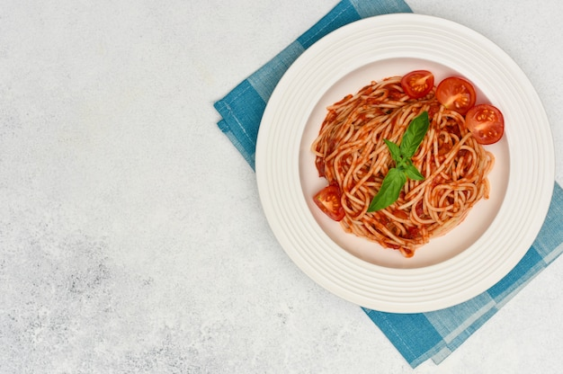 Spaghetti with cherry tomatoes and basil. italian cuisine
