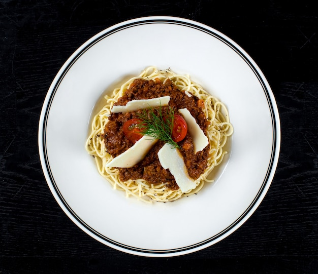 Spaghetti with meat gravy and parmesan