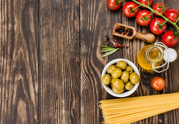 Spaghetti with olives and vegetables with copy-space