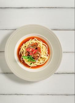 Spaghetti with sardines fish in tomato sauce