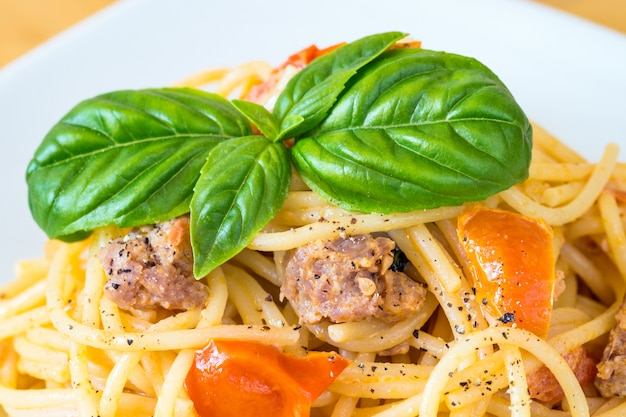 Spaghetti with sausage and cherry tomatoes