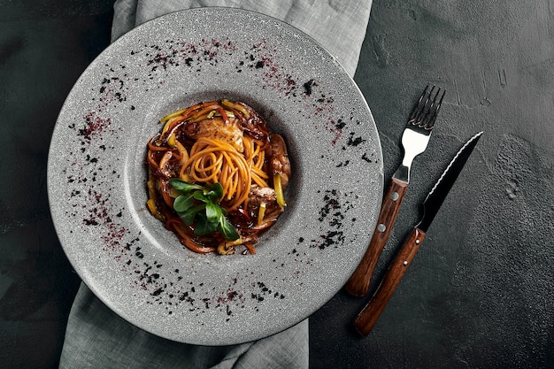 Spaghetti with vegetables tomato sauce and meat. traditional italian food. food photo. dish from the chef. beautiful presentation, macro shooting, close-up, top view.