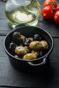 Spain olives fresh, on black wooden table