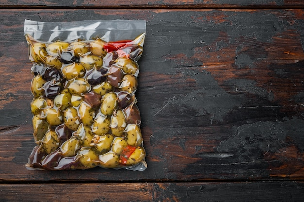 Spain olives fresh, on old wooden table, flat lay  with copy space for text