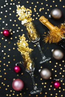 Spangles in glasses with baubles on table