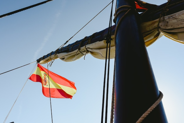 Spanish flag on commercial sailing ship