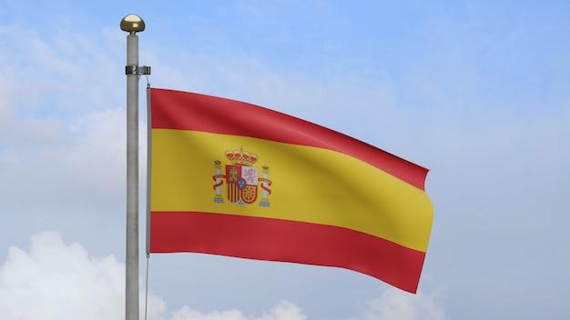 Испанский флаг развевается на ветру и облаках голубого неба