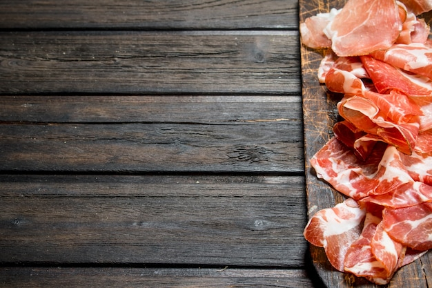 Spanish ham on the chopping board. on a wooden.