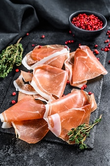 Spanish jamon serrano with thyme, cured ham