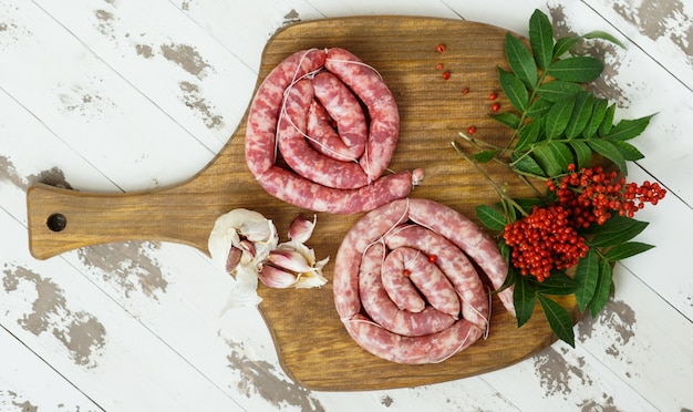 Spanish longaniza, beef sausages  homemade with pink pepper on the cutting board