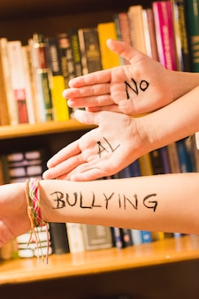 Spanish message against bullying on children's hands