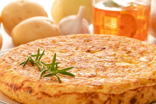 Spanish omelette with potatoes and onion, typical spanish cuisine.