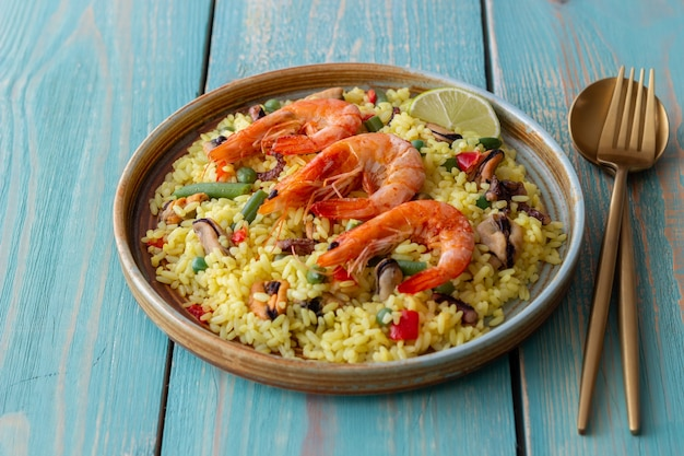 Spanish paella with seafood, shrimp and vegetables. healthy eating. spanish cuisine.