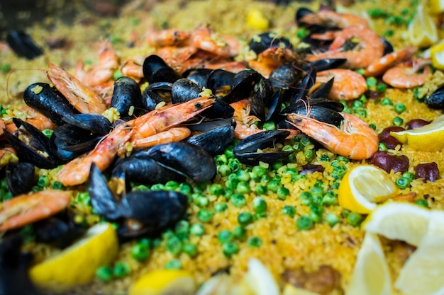 Spanish paella with shrimps, mussels and peas