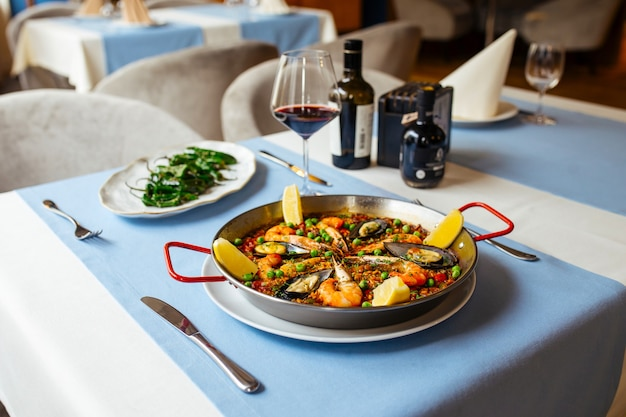 Spanish seafood paella pan with mussels and shrimp