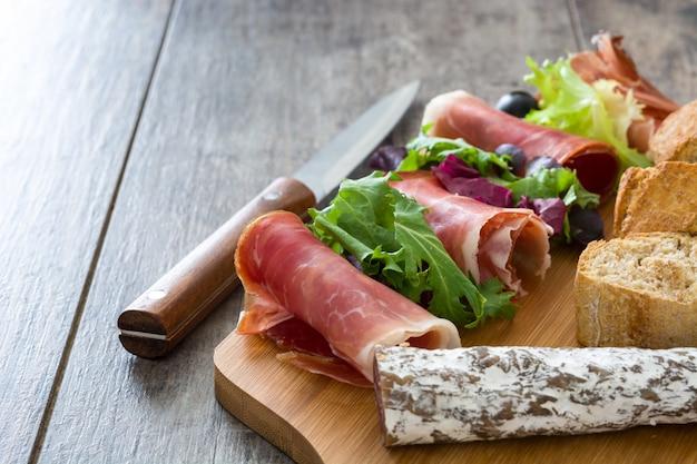 Spanish serrano ham on rustic wood