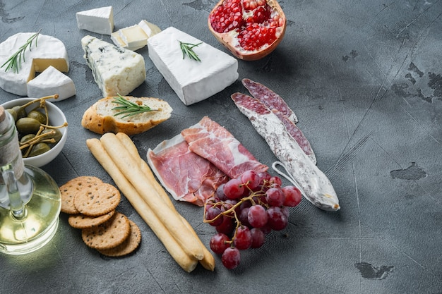 Spanish snacks, meat cheese, herbs set, on gray background  with copy space for text