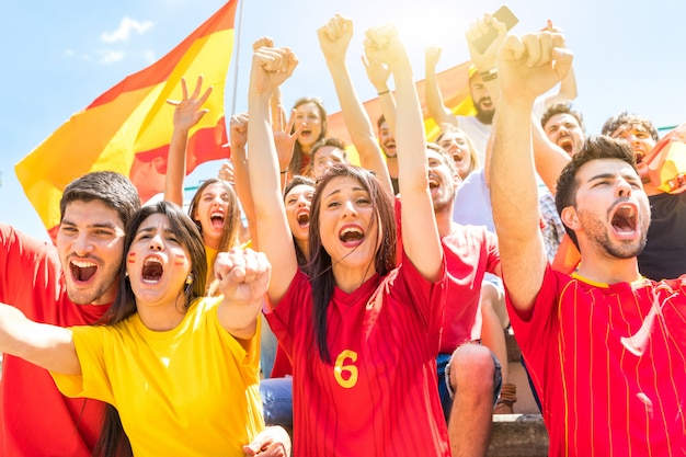 Spanish supporters celebrating and cheering at stadium