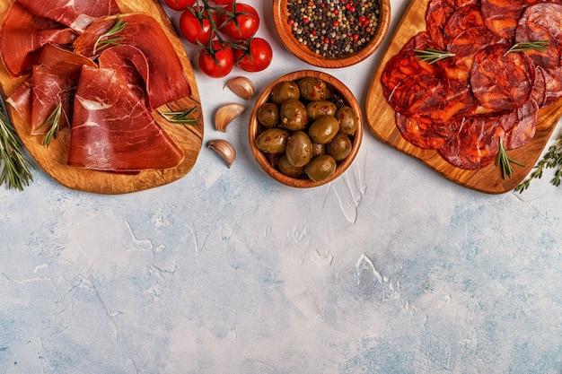 Spanish tapas with chorizo, jamon and olives