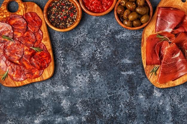Spanish tapas with  chorizo,  jamon, picnic table