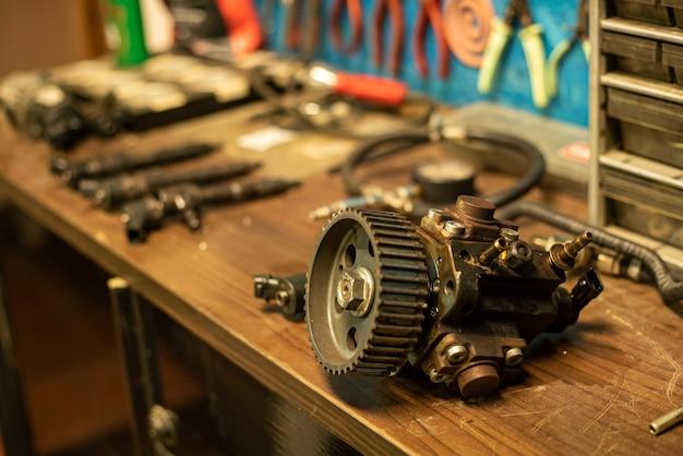 Spare car engine resting on the mechanical workshop bench