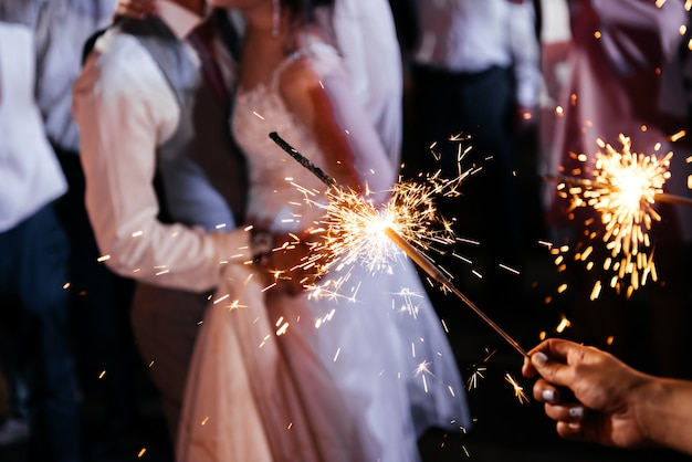 Sparkler in hands on a wedding