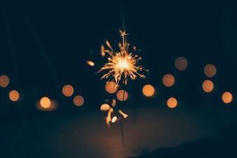 Sparkler on blurred bokeh background