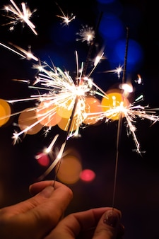 Sparklers burning with bulbs