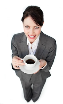 Sparkling businesswoman drinking a cup of coffee