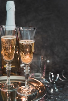Sparkling champagne glasses on a tray