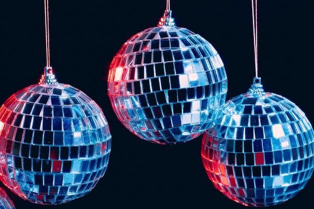 Sparkling disco balls hanging in the air against black