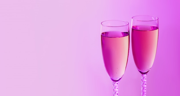 Sparkling new year on the pink neon background with champagne. christmas and happy new year concept. copy space.