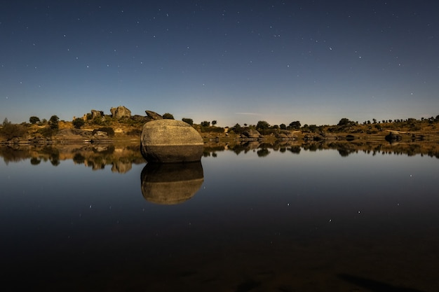 Sparkling night landscape with moonlight in the barruecos natural area