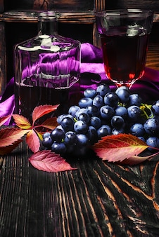 Sparkling red wine and grapes