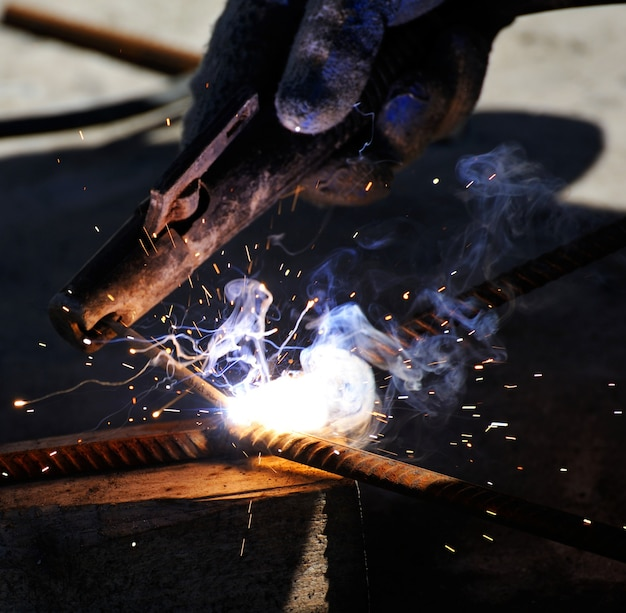 Sparks from welding on a dark background.