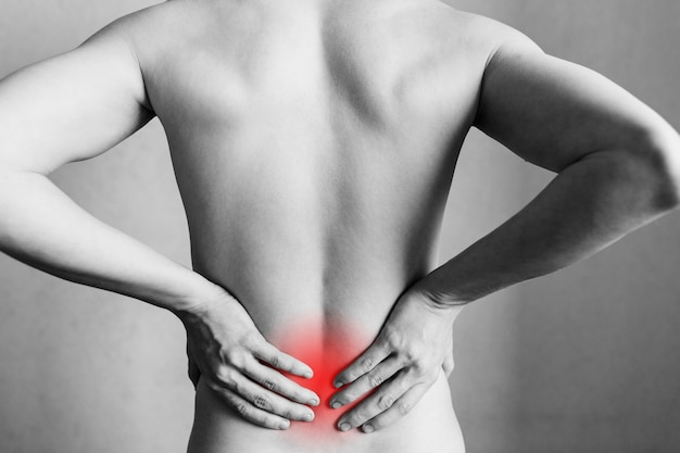Spasm on the mans back injuries to the spine and lower back fatigue at work area of the injury