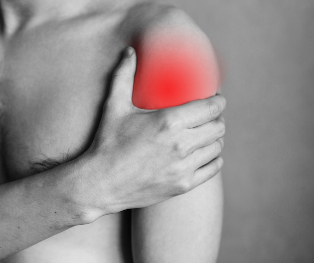 Spasm on the mans shoulder shoulder and joint injuries fatigue at work area of the injury