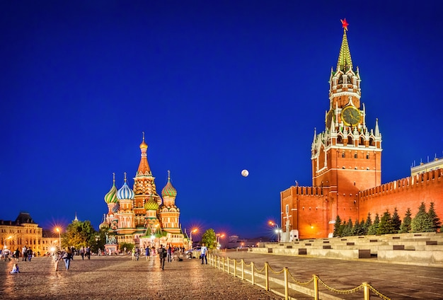Spasskaya tower among people on red square near the walls of the moscow kremlin