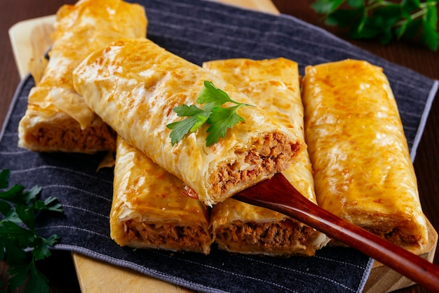 Spatula serves one of the crispy filo pastry rolls filled with tuna