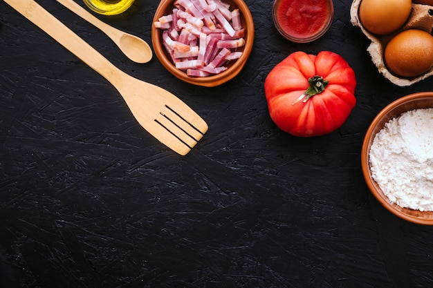 Spatula and spoon near fresh ingredients