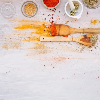 Spatulas near spilled spices
