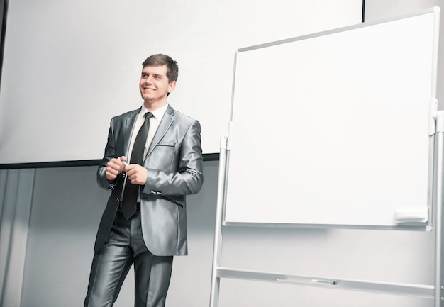Speaker at business conference and presentation with a blank presentation board
