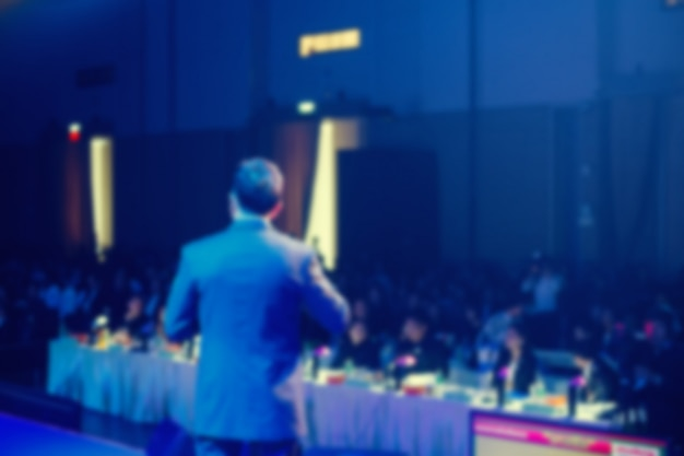 Speaker on stage and giving talk at business meeting