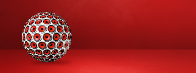 Speakers sphere isolated on a red studio banner. 3d illustration