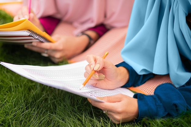 Speaking and studying. beautiful smart muslim students wearing hijab speaking and studying together