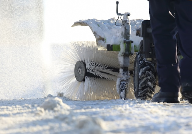 Special snow machine clears snow on the city street